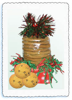 The chocolate chip cookie gift is packaged in a bright red basket.