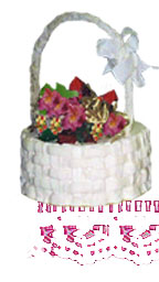 Photograph of a basket shaped cake filled with autumn flowers and leaves.