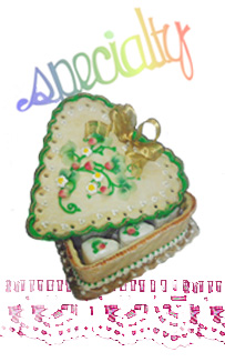 graphic of an edible gift box containing petits fours decorated by a decorative font reading specialty